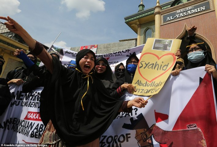 INDONESIA: Protesters voice their anger at the offensive cartoons in Medan today, with one holding a placard celebrating Abdullah Anzorov, the Chechen terrorist who murdered school teacher Samuel Paty near Paris