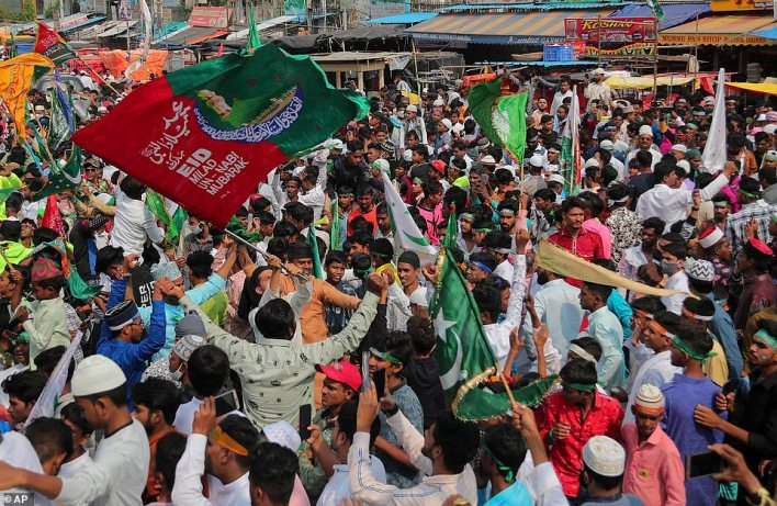 INDIA: People shout slogans during protests in Hyderabad today as tensions continue to rise after Thursday's terror attack