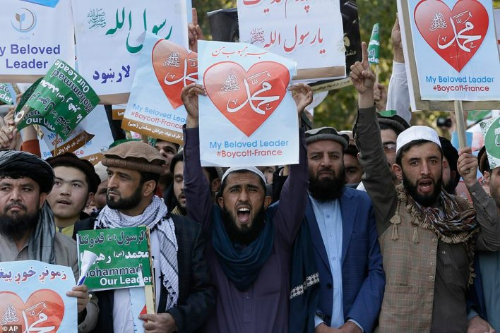 Afghans shout slogans during a protest against French President Macron's comments over Prophet Muhammad caricatures, in Kabul, Afghanistan