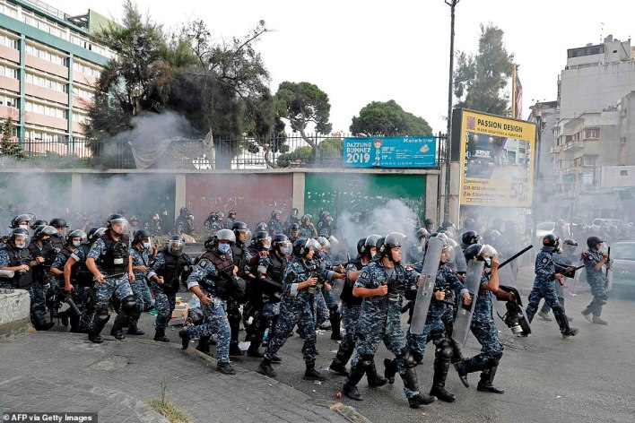 Lebanese riot police deploy amid clashes with demonstrators protesting French President Emmanuel Macron's comments in Beirut on Friday