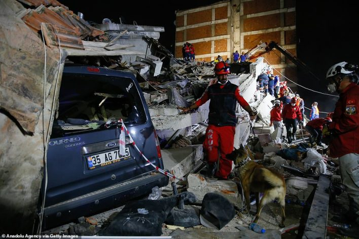 Search and rescue teams continue to look for survivors with dogs in Izmir