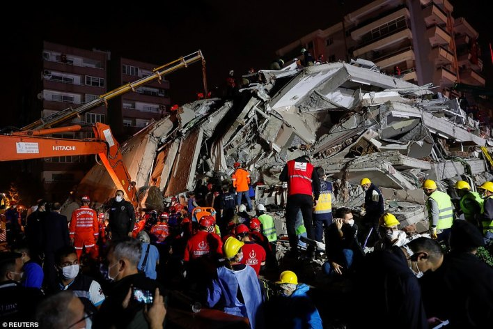 Rescue operations take place on a collapsed building after the earthquake