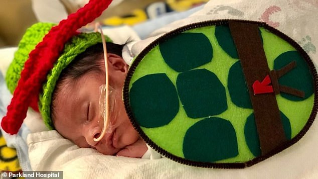 Giving back: Meanwhile, Child Life specialists at Parkland Hospital in Dallas hosted a socially-distanced craft party to make costumes for their NICU babies, including this Ninja Turtle