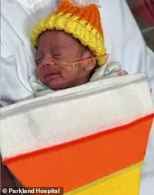 Unforgettable: One newborn was dressed as Elvis Presley, while another donned a candy corn costume