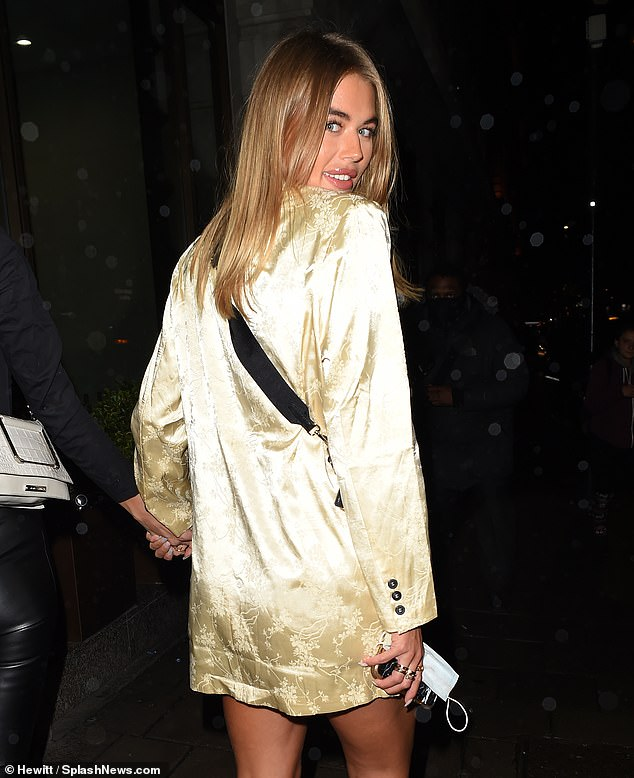 Glowing: The star dropped her blonde locks over her shoulders and opted for a glamorous makeup look for her evening