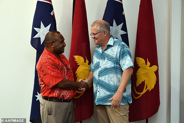 Prime Minister Scott Morrison (right) shakes hands with Prime Minister of Papua New Guinea James Marape (left) at the Pacific Islands Forum in Tuvalu in August 2019. Papua New Guinea is another island Pacific that could benefit from Australian vaccine funding