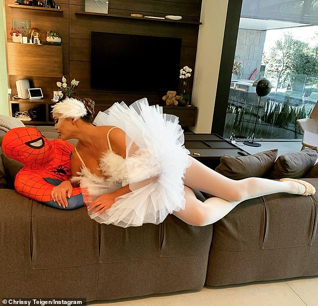 So in love:At one point during her Insta Story she could be seen straddling her dashing husband John Legend who was in a Spider-Man costume