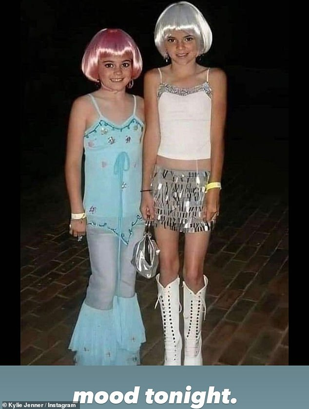 Sister act:Kylie Jenner also demonstrated her 'mood' that night with a throwback snap that showed a childhood costume she did with her sister Kendall