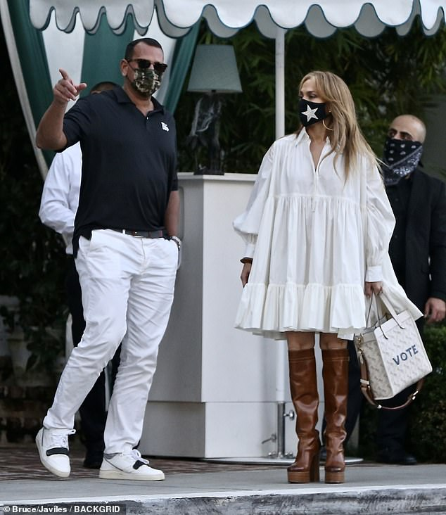 Safety first:Adhering to California's strict mask mandate, Lopez and her soon-to-be husband made sure to done face masks as they waited for their table