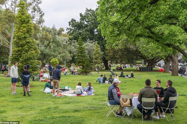 Locals dining out and enjoying picnics at the Botanical gardens in Melbourne on Saturday (pictured) as restrictions finally eased after three months in lockdown