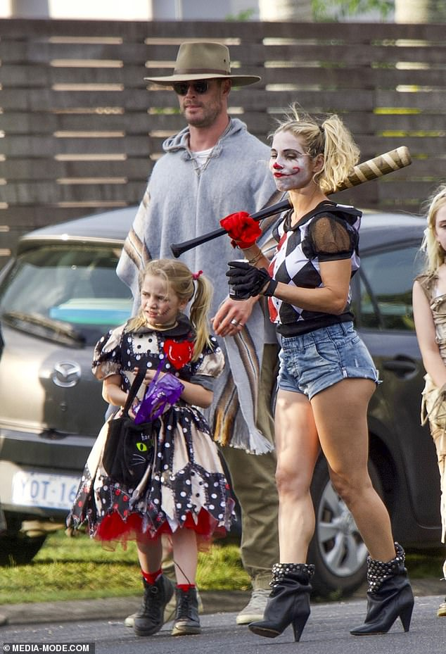 Original Costume: The couple's eldest daughter, India Rose, eight, wore a dress with an elaborate patchwork pattern.  She was carrying a black bag with a cat on the front, filled with treats she had received from their neighbors
