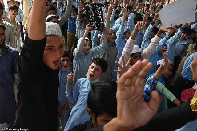 Students of Jamaat-e-Islami party shout slogans during an anti-France protest in Lahore today
