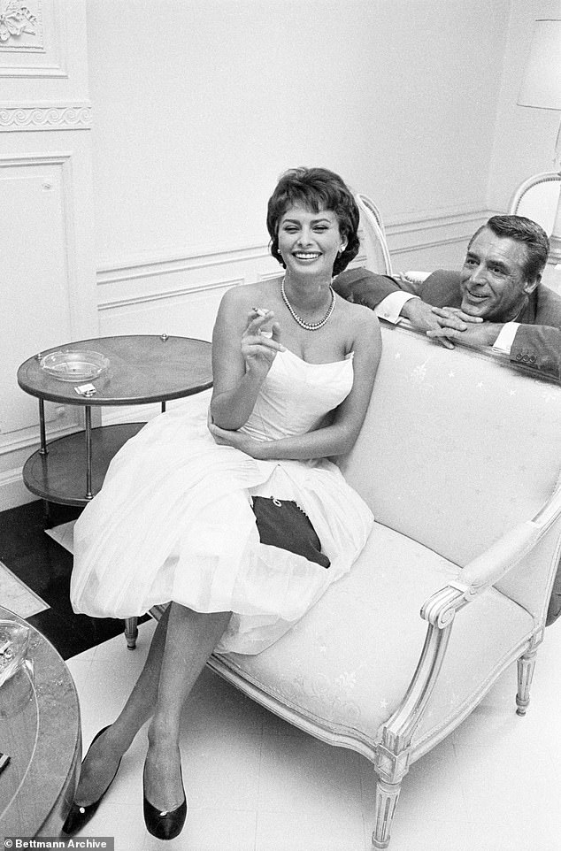 Sophia added that she hasn't been able to see any of her four grandchildren, aged between eight and 14, or her sister, who lives in Rome. She is pictured with Cary Grant in the 1950s