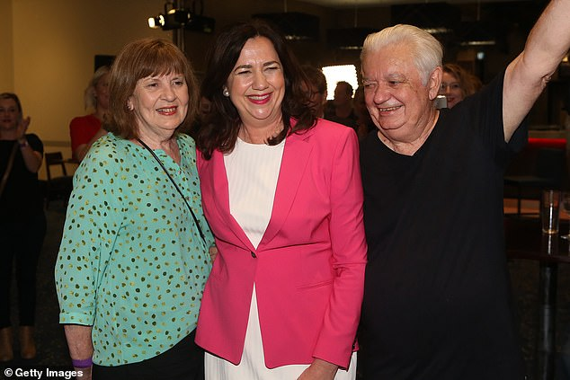 With the Halloween election over, Ms Palaszczuk is likely to keep shutting Queensland again whenever a small outbreak flares up against in Sydney or Melbourne, even if exceptions are made for Hollywood stars like Tom Hanks. The premier is pictured with her parents Laurel and her father Henry Palaszczuk, a former Queensland Labor government minister