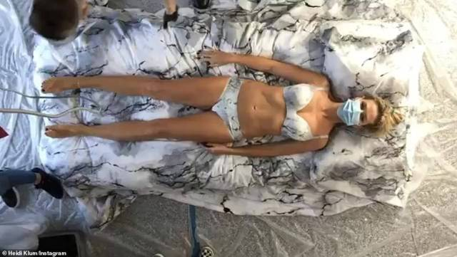 Before: The Making The Cut star reclined on a mattress in one sped-up video post, as a crew of at least four people surrounded her to paint her bodyto take on the desired marble effect