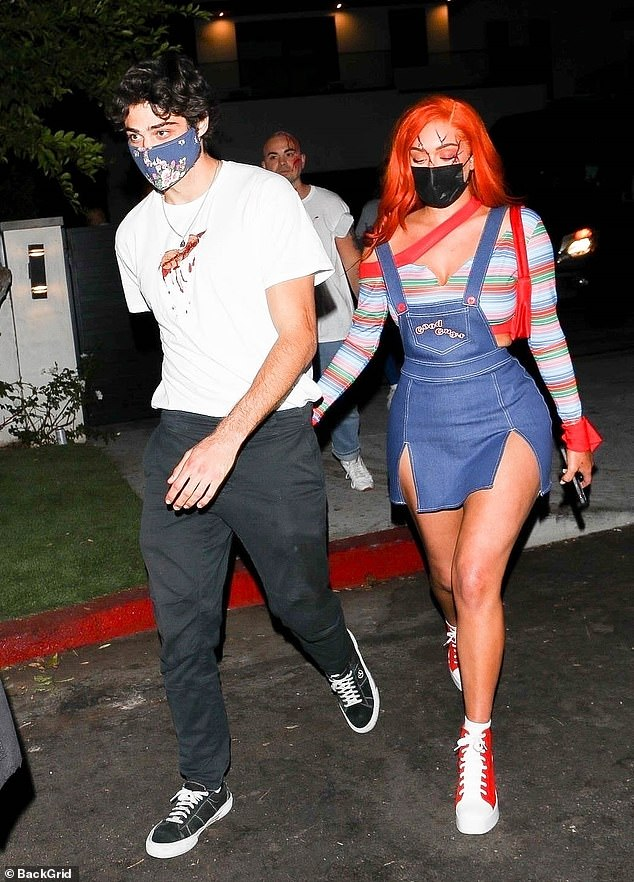 Coordinated costumes: Stassie was dressed as a sexy version of the Chucky doll, while actor Noah presumably dressed as one of her victims with a solitary bloody gash across his chest