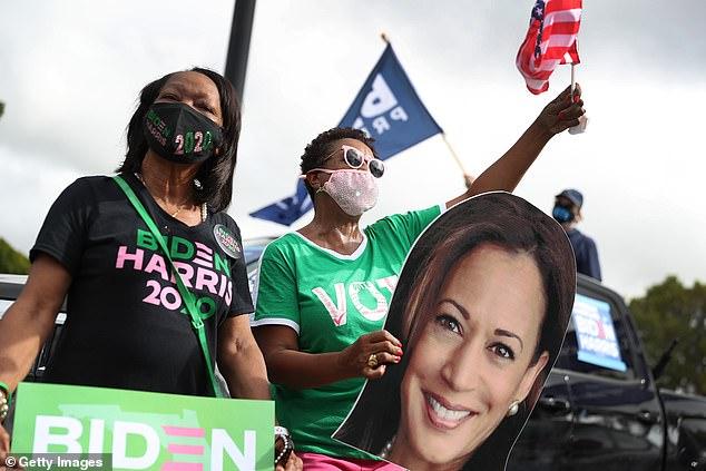 Alpha Kappa Alpha sisters cheer on Sen. Kamala Harris at a Miami, Florida drive-in rally Saturday