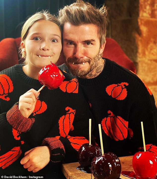 Happy Halloween! Earlier in the day, David had posed with daughter Harper as they donned matching pumpkin jumpers, while sporting a pair of vampire fangs