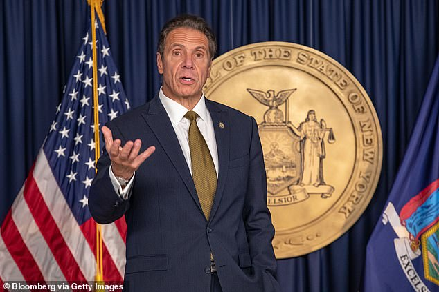 Governor Andrew Cuomo (seen above on October 5 in New York) on Saturday announced a new policy requiring visitors from states not contiguous to New York to take COVID-19 tests within three days before and within four days after arriving in the state. Anyone who tests negative could be out of quarantine after just four days, Cuomo said