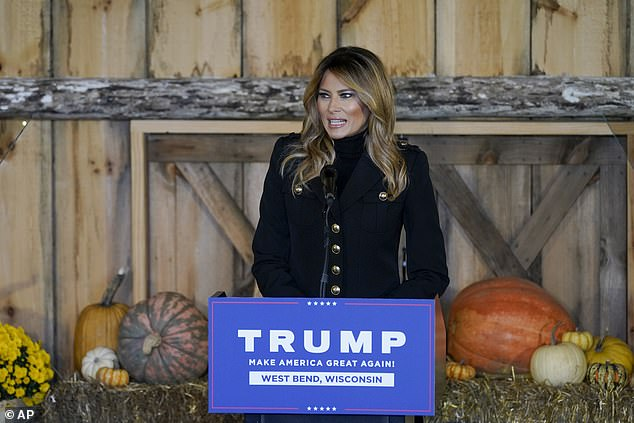 First lady Melania Trump is photographed campaigning Saturday in West Bend, Wisconsin.'Well, at least those rumors that we don't live together turned out to be false,' Trump said in Reading Saturday, pointing out that both he and the first lady got COVID-19