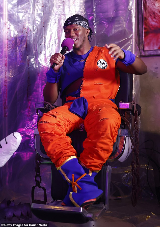 Bright outfit: KSI looked relaxed in his costume as he mingled backstage