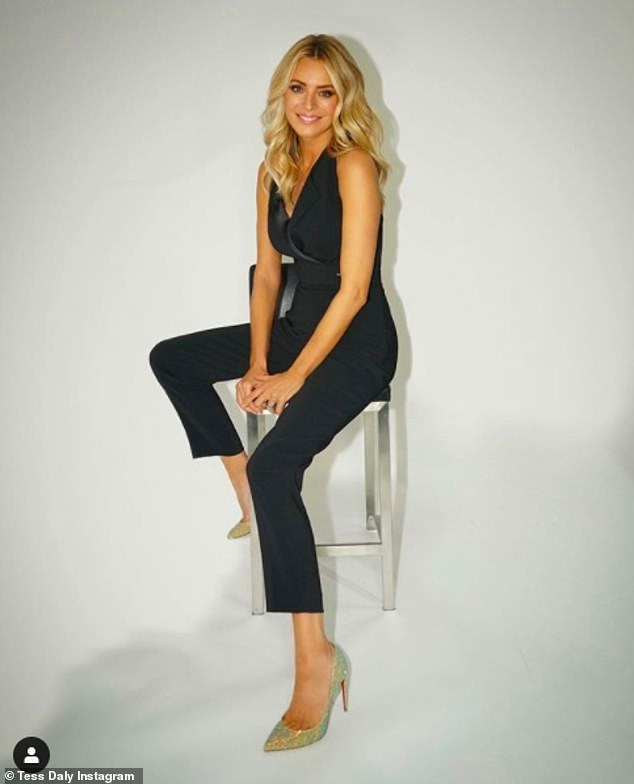 Stylish:Meanwhile presenter Tess Daly, 51, looked every inch the glamorous show host in a black tailored jumpsuit