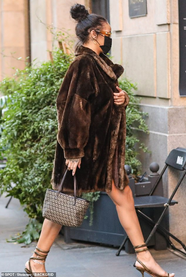 Ready for her closeup: Rihanna served pure opulence Saturday in a leggy brown fur coast, returning to the filming location of a possible music video at the NoMad Hotel in Los Angeles, as her ninth studio album inches closer to completion