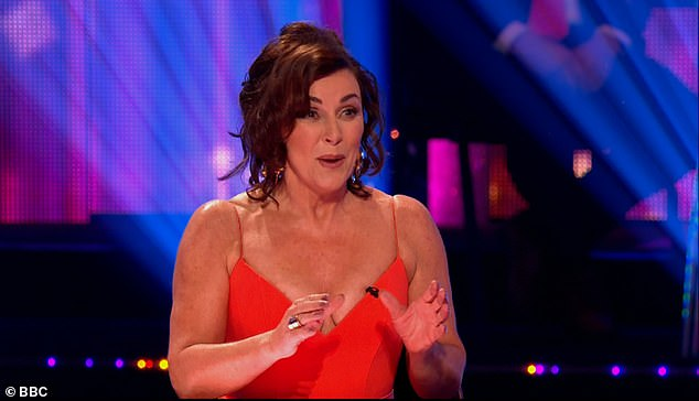 Lovely: The head judge, 60, looked incredible in the flattering red number that fell all the way to the floor and showed off her youthful figure