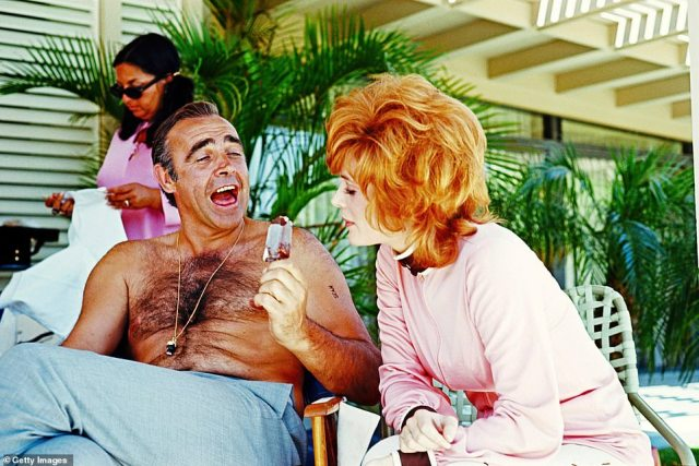 Sean Connery and Jill St John, the stars of James Bond film 'Diamonds Are Forever', share a joke over an ice cream, 1st June 1971