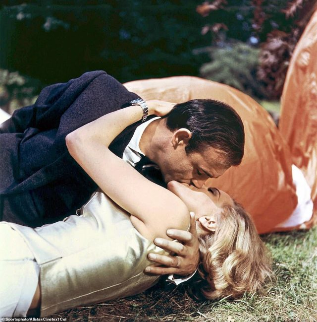 Connery's 007 character kisses Honor Blackman as Pussy Galore in Goldfinger in 1964