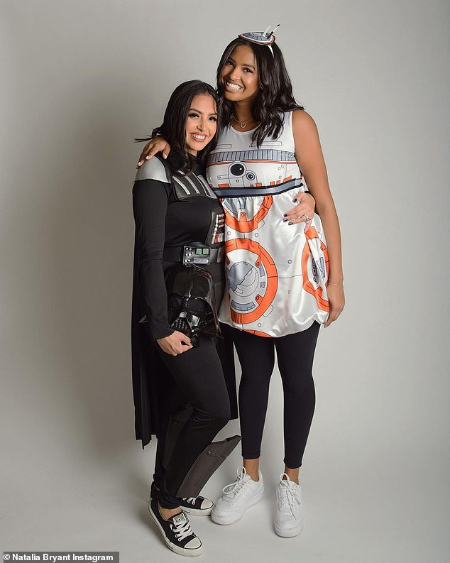 Mother's love: Vanessa cozied up to eldest daughter Natalia for a photo, as the duo that was dressed as Darth Vader and BB-8 held each other close and smiled for the camera