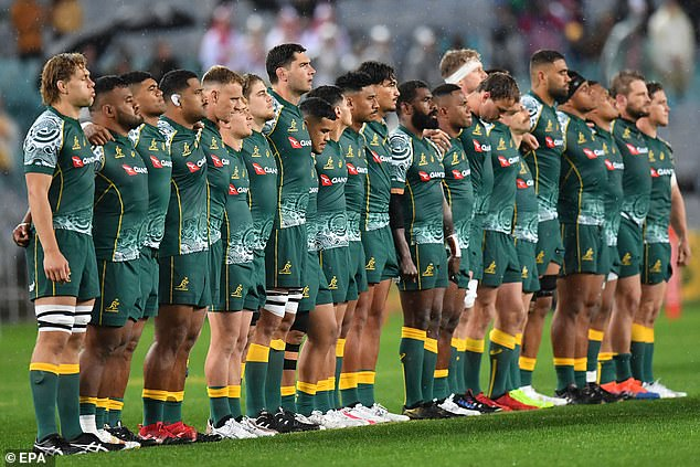 Fans called Mr Nduwimana's rendition of the anthem one of the best of all time. Pictured: the Wallabies huddle before kick off in the third Bledisloe Cup test match at ANZ Stadium
