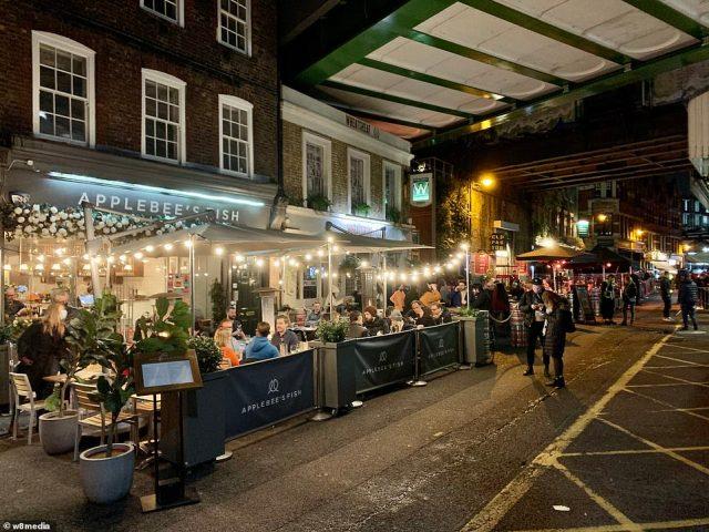 People were seen enjoying drinks in Borough Market, Southwark ahead of England's new month-long lockdown