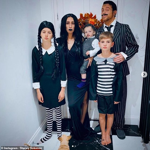 Going all out: Stacey Solomon transformed her brood into The Addams family for Halloween on Saturday