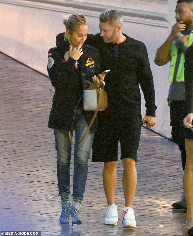 Cosy: She then joined her non-smoker boyfriend for the stroll home