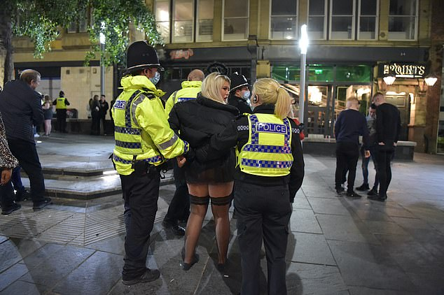 Police officers detain Halloween revellers in Newcastle on Saturday night as Police Federation Chairman John Apter criticised a leak of the Government's lockdown plan