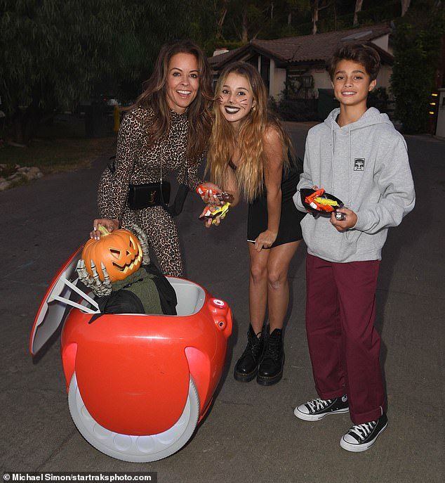 Happy Halloween! Brooke Burke enjoyed safe trick or treating with son Shaya Charvet, daughter Rain Charvet and new family member: Gita, the two-wheeled cargo-carrying robot