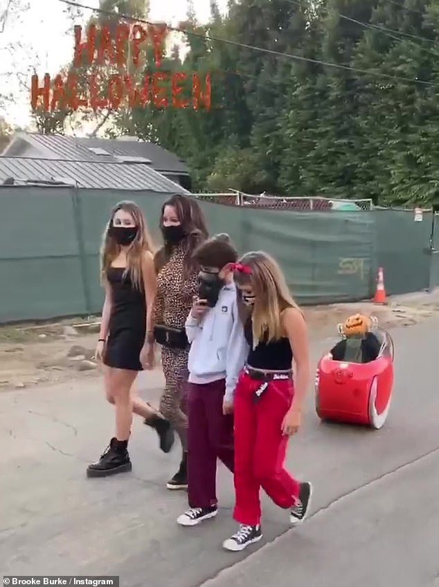 Safety first: While out the family made sure to wear protective masks