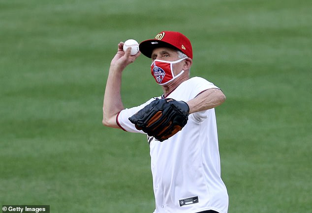 The tweet also mocked Fauci's ball throwing skills. He is pictured here throwing out the ceremonial first pitch prior to the game between the Yankees and Washington Nationals in July
