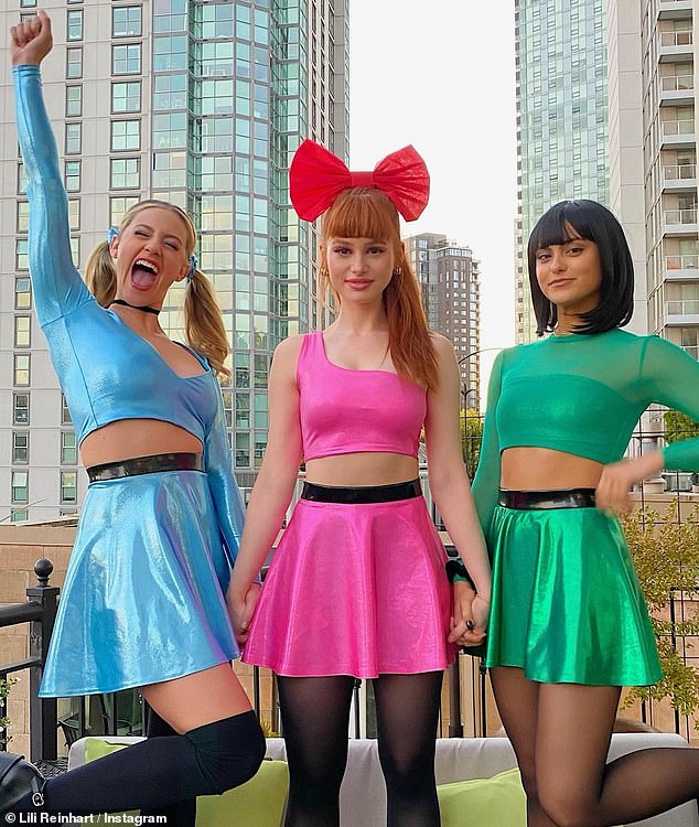 Sugar and spice: Lili Reinhart joined Camila Mendes and Madelaine Petsch for the perfect Powerpuff Girls group costume Saturday, as they attended a Halloween baby shower for their Riverdale costar Vanessa Morgan