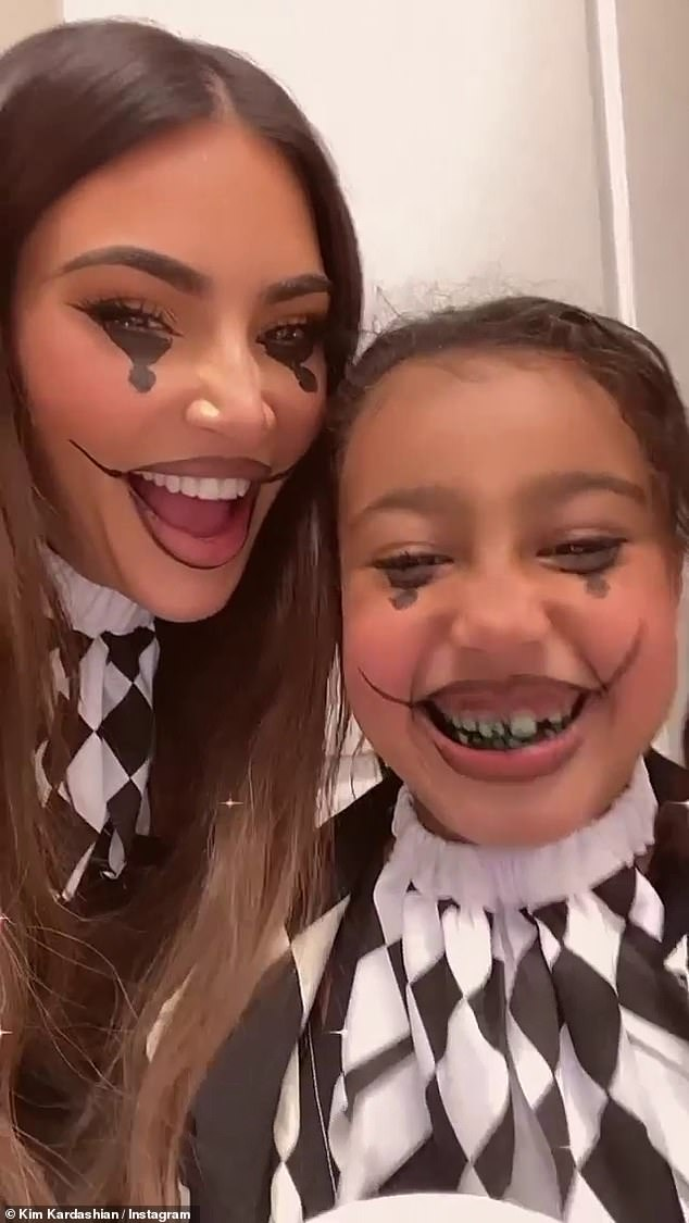 So much fun:Kim Kardashian could be seen wearing matching costumes with her eldest daughter North, seven, as could Kylie Jenner with her firstborn child Stormi, two