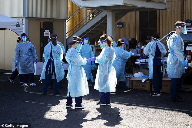 Health care workers assemble at a coronavirus pop up tent in Rushcutters Bay in Sydney on July 29
