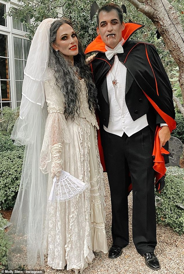 Marriage goals: Husband Scott Stuber, 51, whom she married in September of 2011, complemented her in an equally detailed Count Dracula costume