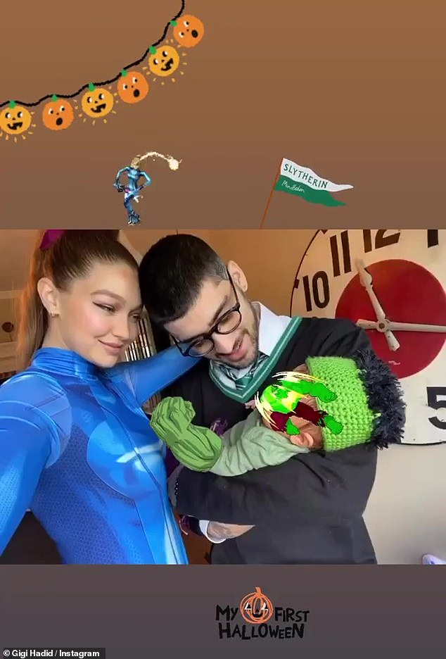 Proud parents: Gigi Hadid gave fans a small glimpse of her baby daughter in a Halloween snap with beau Zayn Malik on Saturday