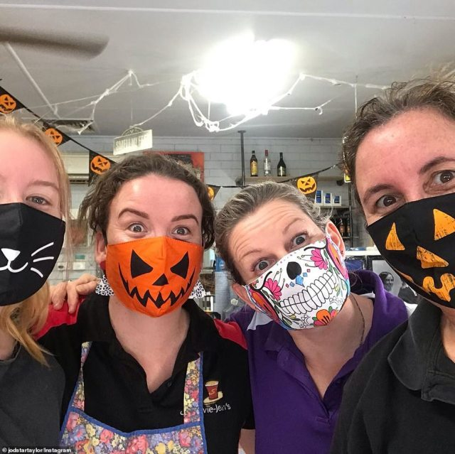 Hospitality workers in Queensland sported Halloween-decorated face masks, featuring Jack-o'-lanterns, a cat, and a Day of the Dead print
