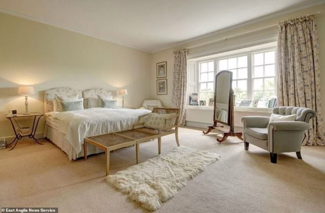 The palatial property (pictured is one of the bedrooms) - which has its own outdoor swimming pool and tennis court, just like Anmer Hall - is coming up for rent unfurnished next spring