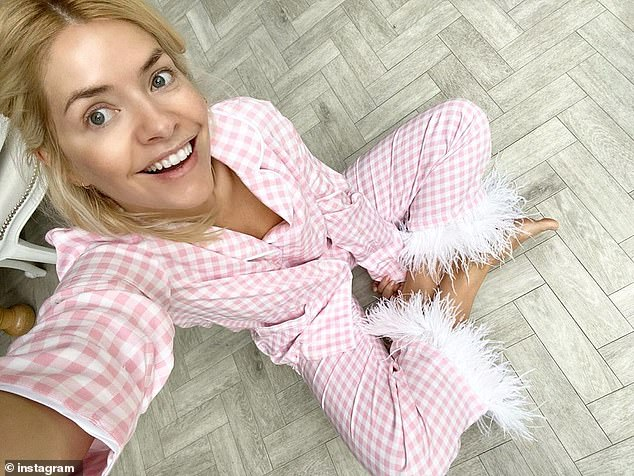 Lockdown look:Holly's sneak peak came soon after she took to Instagram on Sunday morning to show off her pink pyjamas as she prepares for the four-week lockdown