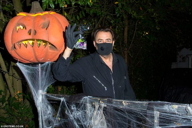 Spooky:Jonathan Ross had a much more subdued October 31 this year as he greeted trick-or-treaters outside his London home on Saturday