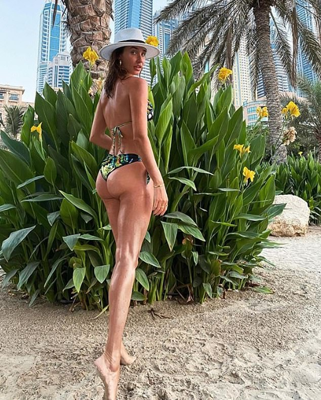 Sun-kissed: Megan McKenna showcased her slender curves during her luxury getaway to Dubai as she shared a holiday snap to her Instagram on Sunday