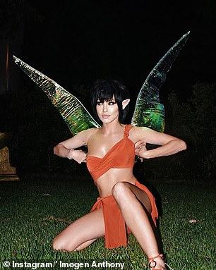 Wow! Her costume included a black wig, orange skirt and bikini top, elf ears and huge wings